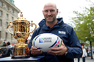 England rugby legend Lawrence Dallaglio holds an official Rugby World Cup 2015 match ball as he poses next to the Webb Ellis Trophy. RWC 2015, Coca Cola London Eye launch for the Rugby World cup event  in London on Tuesday 15th Sept  2015.<br /> pic by John Patrick Fletcher, Andrew Orchard sports photography.