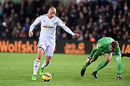 Jonjo Shelvey of Swansea city (l) tries to go past QPR goalkeeper Robert Green. Barclays Premier league match, Swansea city v Queens Park Rangers at the Liberty stadium in Swansea, South Wales on Tuesday 2nd December 2014<br /> pic by Andrew Orchard, Andrew Orchard sports photography.