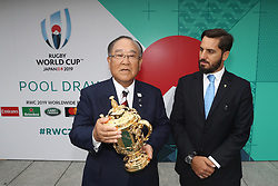 KYOTO, JAPAN - MAY 10: Fujio Mitarai, Chairman of the RWC 2019 Organising Committee receives the William Webb Ellis cup from Agustin Pichot, Vice-Chairman of World Rugby during the Rugby World Cup 2019 Pool Draw at the Kyoto State Guest House on May 10, in Kyoto, Japan. Photo by Dave Rogers - World Rugby/PARSPIX/ABACAPRESS.COM