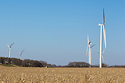 Wind turbines in rural areas are part of the new sustainable energy future of the United States. This wind farm is under construction in Freeborn County Minnesota.