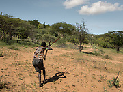 Hunting small game with bow and arrows. At the Hadza camp of Dedauko.