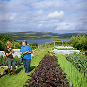 Vegetable grower Anthony Tovey and restaurant owner Shirley Spear chatting at Anthony's croft in Totaig, Isle of Skye, Scotland, UK. Anthony Hovey grows a wide range of vegetables at his croft in Totaig which he supplies to The Three Chimneys restaurant in Colbost, 2 miles away.