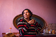 "Bozena (58) who lives since 32 years at the Lunik IX housing estate in the living room of their flat. She witnessed how the estate changed into a ""dunghill"" - as she said herself - during those years. The family had to move out of the decrepit building where Bozena had her first flat. ""Hrebenova 34-36"" was demolished by the city of Kosice in August 2014. Lunik IX has officially 6542 registered (12/2015) inhabitants and almost all of them are of Roma ethnicity."