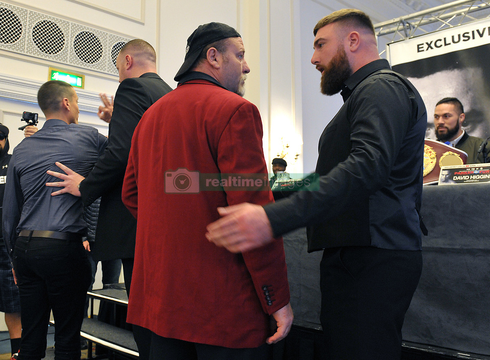 WBO heavyweight champion Joseph Parker (right) watches as security officers usher away boxing promoter David Higgins (left) and an unidentified colleague (centre) after they interrupted the pre-fight press conference for the WBO heavyweight title challenge fight against Hughie Fury in Manchester on Saturday, at the Landmark Hotel, London.