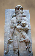 Stone relief sculptured panel of a Hero holding a lion. From the facade of the throne room,  Inv AO 19862 from Dur Sharrukin the palace of Assyrian king Sargon II at Khorsabad, 713-706 BC.  Louvre Museum Room 4 , Paris .<br /> <br /> If you prefer to buy from our ALAMY PHOTO LIBRARY  Collection visit : https://www.alamy.com/portfolio/paul-williams-funkystock/ancient-assyria-antiquities.html  Refine search by adding background colour, place, subject, museum etc into the LOWER SEARCH WITHIN GALLERY box to <br /> <br /> Visit our ANCIENT WORLD PHOTO COLLECTIONS for more photos to download or buy as wall art prints https://funkystock.photoshelter.com/gallery-collection/Ancient-World-Art-Antiquities-Historic-Sites-Pictures-Images-of/C00006u26yqSkDOM