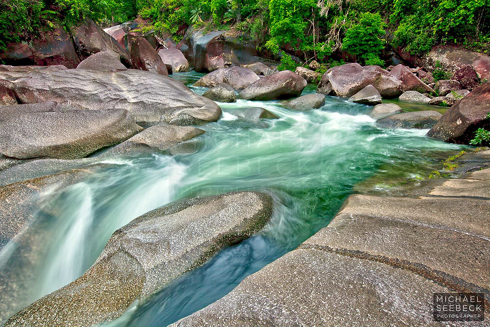 """Pure clear water from upland rainforests flows through """"The Boulders""""<br /> <br /> Open Edition Print & Stock Image."""