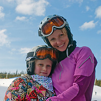 A mother and daughter hug each other at Big Sky ski area, Big Sky, Montana.