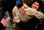 Maria Thottukadavil (right) hugs her son Charlie James (left), who recently arrived home from a tour of duty in Iraq, at the Red Bank Marines Reserve Center in Red Bank, New Jersey on March 22, 2008.  Hundreds of family and friends from Middlesex and Monmouth Counties gathered at the facility to greet their Marines.