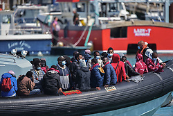 © Licensed to London News Pictures. 5/08/2021. Dover, UK. Migrants carries arrive on a Border Force boat at Dover Harbour in Kent after crossing the English Channel. Hundreds of migrants have made the crossing in recent weeks. Photo credit: Stuart Brock/LNP