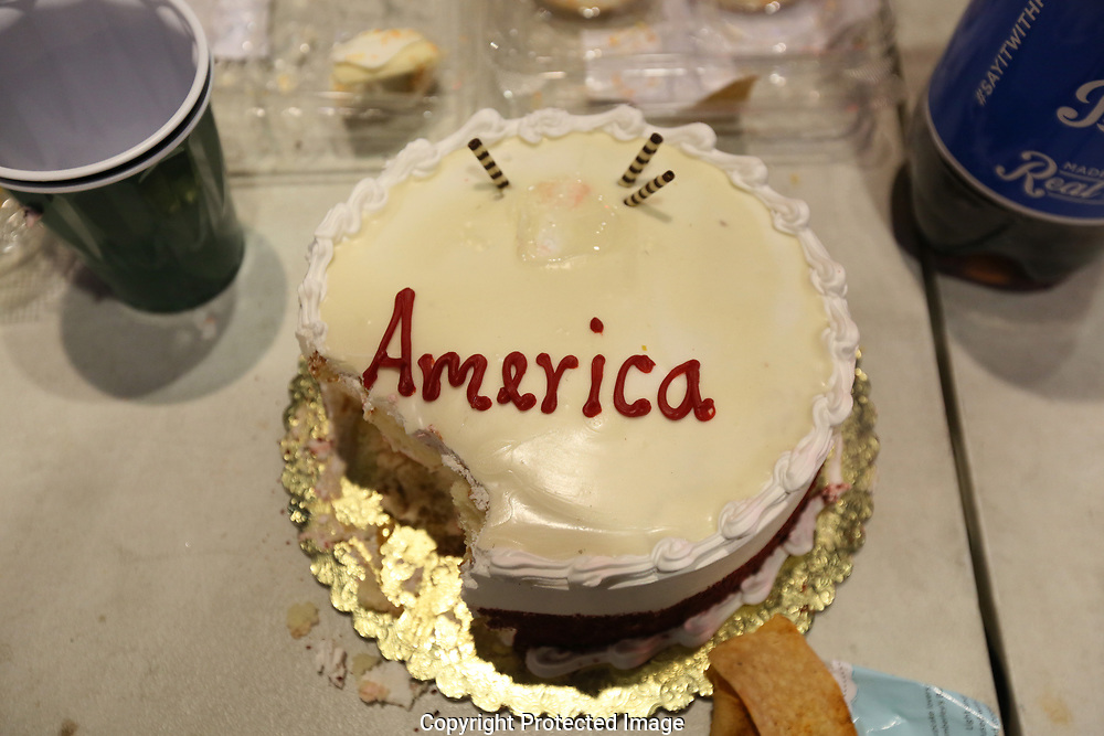 """""""Trumpeteers"""" with a celebration cake at Donald Trump's star on the Hollywood Walk of Fame on the same day of the protest to the election of Republican Donald Trump as President of the United States in Los Angeles, California, U.S. November12, 2016.  REUTERS/Ted Soqui"""