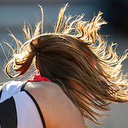 PARIS, FRANCE June 1.  The hair of Aleksandra Krunic of Serbia flicks over her face while serving against Coco Gauff of the United States on court six during the first round of the singles competition at the 2021 French Open Tennis Tournament at Roland Garros on June 1st 2021 in Paris, France. (Photo by Tim Clayton/Corbis via Getty Images)