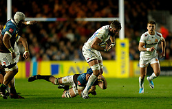Exeter's Geoff Parling is tackled by Harlequins' James Horwill during the Aviva Premiership match at Twickenham Stoop, London.