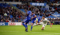 Burnley's Sam Vokes scores his side's second goal of the game during the Premier League match at the Cardiff City Stadium.