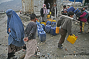 Villagers fetch water in Kabul, Afghanistan.
