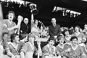 The Tipperary captain receiving the cup surrounded by his cheering teammates after winning the All Ireland Minor Hurling Final, Tipperary v Kilkenny in Croke Park on the 5th September 1976.
