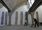 A worker sweeps in Gallery 798 in Beijing.