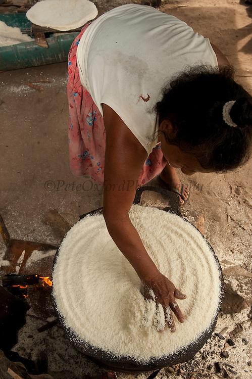Woman making Cassava Bread. <br /> Madene Oswald. MODEL RELEASE GYA#9<br /> Fairivew Amerindian Village<br /> Iwokrama Forest Reserve<br /> GUYANA<br /> South America