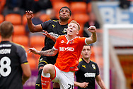 Wimbledon midfielder Tom Soares (19) challenges with Blackpool midfielder Callum Guy (25), on loan from Derby County,  during the EFL Sky Bet League 1 match between Blackpool and AFC Wimbledon at Bloomfield Road, Blackpool, England on 20 October 2018.