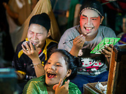 17 OCTOBER 2018 - BANGKOK, THAILAND:  Girls laugh while putting on their makup before the Chinese opera on the last night of the Vegetarian Festival at Chit Sia Ma Shrine in Bangkok's Chinatown. The Vegetarian Festival, also called the Nine Emperor Gods Festival, is a nine-day Taoist celebration beginning on the eve of 9th lunar month of the Chinese calendar. Traditional Chinese operas, called Ngiew in Thailand, are sponsored at many Chinese shrines and temples during the Vegetarian Festival.   PHOTO BY JACK KURTZ