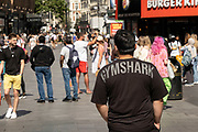Man wearing a Gymshark t-shirt on 2nd July 2021 in London, United Kingdom.