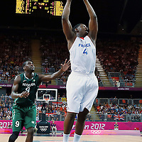 06 August 2012: France Kevin Seraphin grabs an offensive rebound during 79-73 Team France victory over Team Nigeria, during the men's basketball preliminary, at the Basketball Arena, in London, Great Britain.