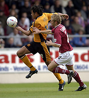 Photo: Richard Lane.<br />Northampton Town v Hull City. Nationwide Division Three. 04/10/2003.<br />Jason Price takes the ball past Chris Carruthers.