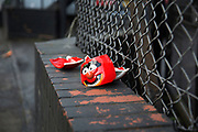 Broken mug of the Animal character from the Muppets on a wall in Birmingham, England, United Kingdom.
