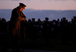 © Licensed to London News Pictures. <br /> 16/12/2014. <br /> <br /> Hartlepool, United Kingdom<br /> <br /> A sunrise vigil is mounted during a memorial event to commemorate the bombardment of Hartlepool by German warships during World War One. During the bombardment 130 civilians were killed and more than 500 were wounded. The Headland's Heugh Gun Battery returned fire in what was the only battle to be fought on British soil during World War One, and one of the Battery's soldiers, Theo Jones of the Durham Light Infantry, became the first British soldier to be killed by enemy action on home ground in the war.<br /> <br /> Photo credit : Ian Forsyth/LNP