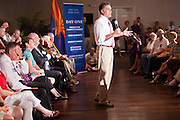 14 SEPTEMBER 2011 - SUN LAKES, AZ: Mitt Romney (CQ) speaks in a packed ballroom at the Oakwood Clubhouse at Sun Lakes Wednesday. Romney was one of the first of the 2012 Republicans running for the GOP Presidential nomination to come to Arizona. He campaigned Wednesday in Tucson and Sun Lakes and attended a private event in Tempe.       PHOTO BY JACK KURTZ