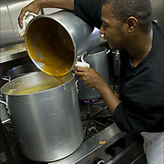 """Volunteers preparing food for Thanksgiving for the homeless a week in advance. <br /> <br /> Jean Webster, a former casino chef 74, found her calling when she saw a man rummaging through a garbage can in search of food. Now she runs a soup kitchen that feeds up to 400 homeless people a day, five days a week in the dinning room of the First Presbyterian Church of Atlantic City.<br /> <br /> No one is turned away. Jean has been called """"Sister Jean"""" or """"Saint Jean"""" or """"the Mother Teresa of Jersey."""" <br /> <br /> She also offers employment counseling and a program designed for transitional housing."""