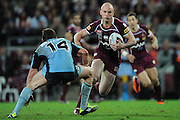July 6th 2011: Maroons captain, Darren Lockyer takes on the Blues defence during game 3 of the 2011 State of Origin series at Suncorp Stadium in Brisbane, QLD, Australia on July 6, 2011. Photo by Matt Roberts / mattrimages.com.au / QRL