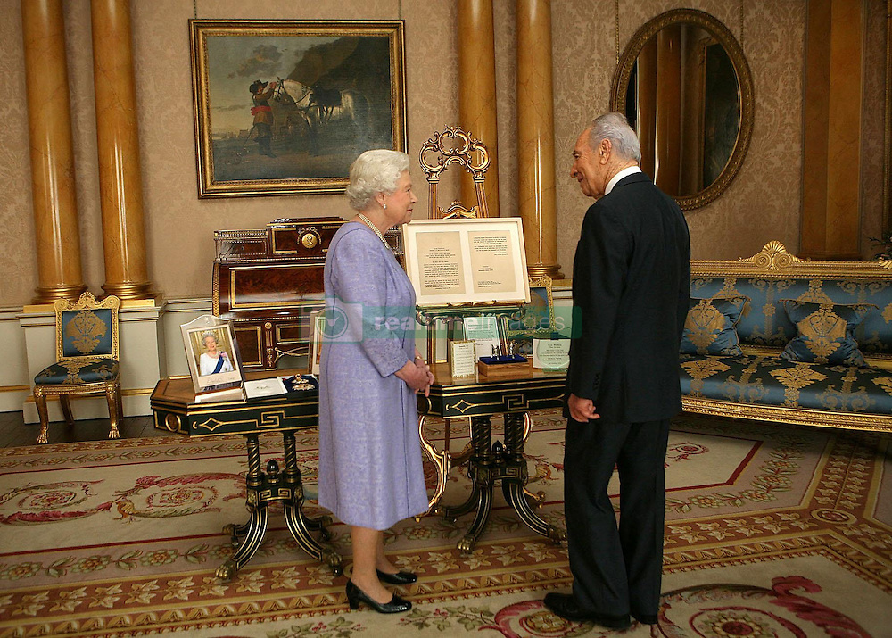 File photo dated 20/11/08 of Britain's Queen Elizabeth II receiving former Israeli President Shimon Peres, who has died aged 93.