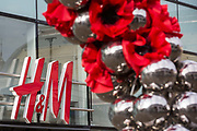 "Remembrance poppies are displayed in front of a branch of Swedish fashion chain H&M (Hennes & Mauritz AB) on the second day of England's second coronavirus lockdown on 6 November 2020 in Windsor, United Kingdom. Only retailers selling ""essential"" goods and services are permitted to remain open to the public during the second lockdown provided that they follow coronavirus guidelines and make their premises COVID-19 secure."