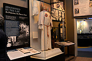 Photo ©Suzi Altman 12/5/17 Jackson,MS   Pictued is a KKK, Klu Klux Klan robe on dislay, in the new Mississippi Civil Rights Museum, the robe and mask were found in a Jackson MS. home. President Trump is expected to attend the opening of the Mississippi Civiil Rights and History Museums. Protests are planned in response to President Trumps announced attendance of the opening of the Civil Rights Museum. Photo©SuziAltman