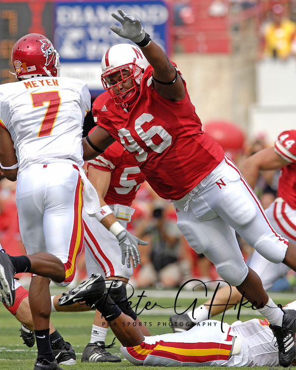Nebraska defensive tackle Titus Adams (96) pressures Iowa State quarterback Bret Meyer (7) during the first half of the Huskers double overtime 27-20 win against the Cyclones at Memorial Stadium in Lincoln, Nebraska, Oct. 1, 2005.
