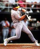 SAN DIEGO, CA-JULY 14:  MLB slugger Mark McGwire of the Oakland Athletics connects with a pitch and bends his bat during the 1992 MLB All Star game held at Jack Murphy Stadium in San Diego, California on July 14, 1992..  McGwire played for the A's from 1986-1997.  (Photo by Ron Vesely)