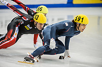 Apolo Anton Ohno (USA) leads from Francois-Louis Tremblay (CAN) in the mens 1000m semi finals
