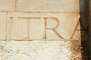 Roman lettering in the reused masonary from an earlier Roman temple in the exterior of the Duomo Pisa, Italy . Pisa Cathedral is a medieval Roman Catholic cathedral dedicated to the Assumption of the Virgin Mary, in the Piazza dei Miracoli in Pisa, Italy. It is a notable example of Romanesque architecture, in particular the style known as Pisan Romanesque.It is the seat of the Archbishop of Pisa. Construction on the Pisa cathedral began in 1063, in the early 12th century the cathedral was enlarged under the direction of architect Rainaldo.