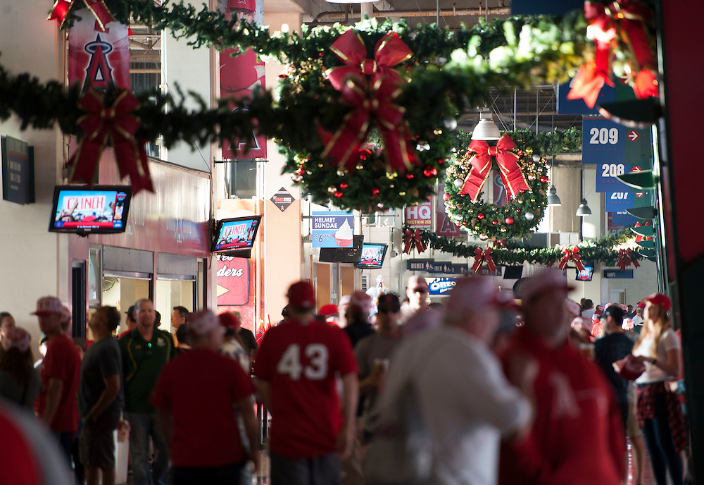 The halls are decked with holiday decorations during the Angels' Christmas in June promotion Friday.<br /> <br /> ///ADDITIONAL INFO:   <br /> <br /> angels.0625.kjs  ---  Photo by KEVIN SULLIVAN / Orange County Register  --  6/24/16<br /> <br /> The Los Angeles Angels take on the Oakland Athletics Friday at Angel Stadium.<br /> <br /> <br />  6/24/16