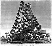 William Herschel's (1738-1822) reflecting telescope with focal length of 40 feet (12.19m), showing top of brick foundation and wheeled platform on which the instrument mounted. Slough, England. Engraving 1809.