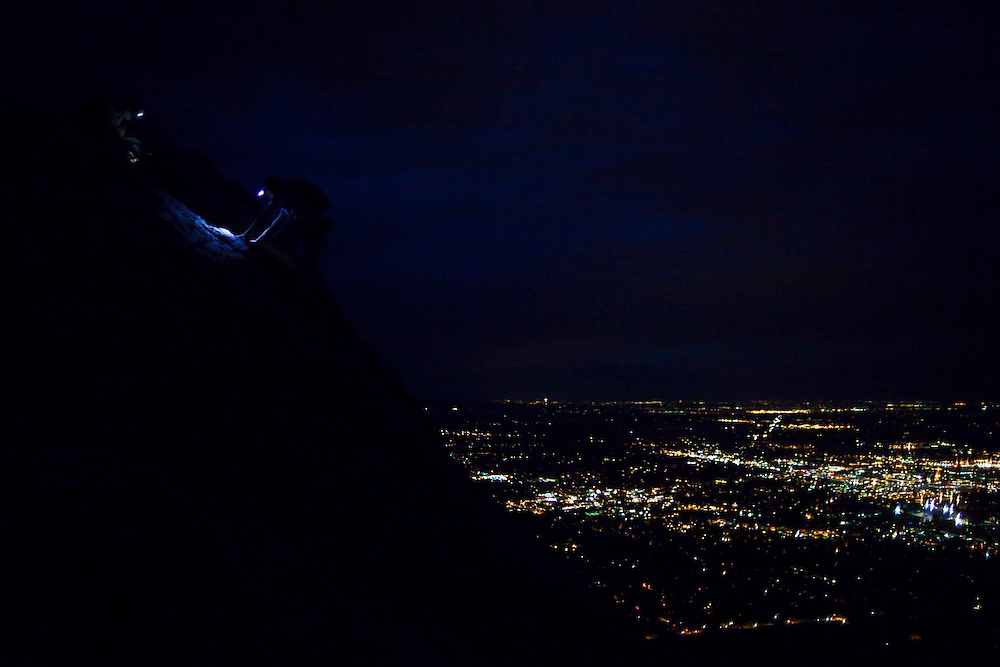 Obadiah Reid and Grace Marx climb the First Flatiron at night on July 4th for a great view of the Boulder, Colorado fireworks display.