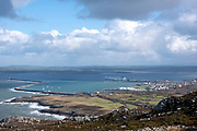 A view over Holyhead port from one of the trail walks in Holyhead Breakwater Country Park on the coast of Holyhead, on 20th February 2020 in Anglesey, North Wales, United Kingdom. The country park opened in 1990 and is on the site of an old stone quarry. The stone from the quarry was used to construct the breakwater in Holyhead, the longest in Europe at 2.39km, it was built between 1846 and 1873.
