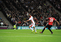 Milton Keynes Dons' Will Grigg chests the ball past Manchester United's David De Gea to score his second of the game - Photo mandatory by-line: Joe Meredith/JMP - Mobile: 07966 386802 26/08/2014 - SPORT - FOOTBALL - Milton Keynes - Stadium MK - Milton Keynes Dons v Manchester United - Capital One Cup