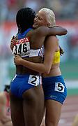 Heptathlon runner-up Eunice Barber of France (left) embraces winner Carolina Kluft of Sweden in the IAAF World Championships in Athletics at Stade de France on Sunday, Aug, 24, 2003.
