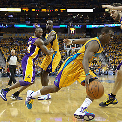 April 22, 2011; New Orleans, LA, USA; New Orleans Hornets point guard Chris Paul (3) drives past Los Angeles Lakers power forward Pau Gasol (16) during the second quarter in game three of the first round of the 2011 NBA playoffs at the New Orleans Arena.    Mandatory Credit: Derick E. Hingle