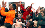 People raise their arms, clap and sing along with the choir during the Martin Luther King Community Celebration service at Mt. Zion First African Baptist church on Sunday. Photo / Ryan M. Kelly / The Daily Progress