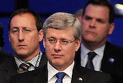 Prime Minister Stephen Harper, middle, sits in front of Minister of Defence Peter MacKay, left, and Minster of Foreign Affairs John Baird as they take part in a meeting on Afghanistan during the NATO Summit in Chicago, Ill., on Monday, May 21, 2012. THE CANADIAN PRESS/Sean Kilpatrick