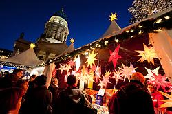 Night view of busy traditional German Christmas Market in Gendarmenmarkt in Mitte Berlin Germany