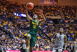 Mar 7, 2020; Morgantown, West Virginia, USA; Baylor Bears guard Jared Butler (12) drives down the lane and shoots during the first half against the West Virginia Mountaineers at WVU Coliseum. Mandatory Credit: Ben Queen-USA TODAY Sports