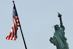 A view of a fluttering American flag with the Statue of Liberty in the background seen from rooftop of the still under-construction of the Statue of Liberty Museum on Liberty Island, in New York City, NY, USA on July 2, 2018. The 26,000 square-foot museum will celebrate the history of the Statue of Liberty and will be home to the original torch. Photo by Dennis Van Tine/ABACAPRESS.COM